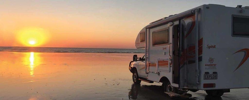 Explorer Motorhomes van parked on a beach
